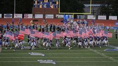A Georgia high school football team ran onto the field Friday night waving American flags.