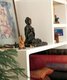 Open shelves are perfect to store cushions, rugs, books and candles in your meditation space.