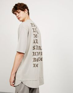 Double layered stonewashed text top. Discover this and many more items in…