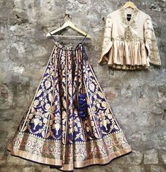 A deep blue woven Benares Lehenga paired with latest Ivory peplum blouse. Contact on +917330687770 or email on jayantireddyofficial@gmail.com for enquiries and orders.