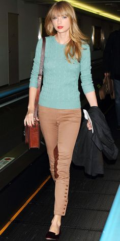 Taylor Swift touched down in Japan wearing a cableknit sweater, tan riding pants, a leather tote and velvet flats.