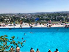 Temperatures in #Wiesbaden are rising so we went to a local pool to sunbathe and swim. The outside gave nothing away as to what it would be like. And wow was I impressed! The entry gives way to a sandy playground on the left a large shady hill on the right full of families relaxing on picnic blankets a huge lap pool with views overlooking all of Wiesbaden and a shallow children's pool. The scenery was stunning! Fig trees span overtop on the sides of the pool and you can peek down at the…