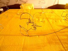 Escultura, caricatura en alambre de LEON DE GREIFF