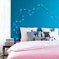 Turn twinkle lights into a headboard.