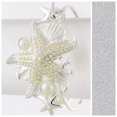 D14 Silver & White Faux Pearl Starfish Bracelet ‼️PRICE FIRM‼️   Starfish Bracelet  Absolutely adorable and fashionable bracelet. Silver color textured metal with faux pearl starfish.  Hinged so it will adjust to your wrist. Boutique Jewelry Bracelets