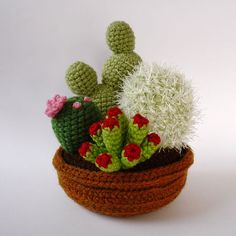 4plant garden of realistic crocheted cacti and by LunasCrafts