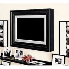 Black and white to conceal TV    http://www.elementsofstyleblog.com/2011/06/concealing-the-evil-neccessity.html