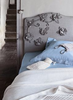 An adorable idea for a headboard; home decor mimics fashion with these felt flowered embellishments. Wool cut out flowers (make or buy) and attach to a like-coloured headboard. This one in linen. Simple and feminine.