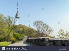 Download this stock image: Walkway, old fortress wall and N Seoul Tower at the Namsan Hill (or Namsan Park or Namsan Mountain) in Seoul, South Korea. - H31BEC from Alamy's library of millions of high resolution stock photos, illustrations and vectors.