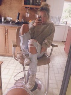Ripped jeans, white high tops, over sized sweater, messy bun