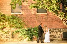 Photographer Jacob Arthur capturing this great couple outside The Foundry with the ivy:-)