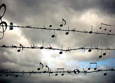 #wallpaper - Partitura musical en alambre de puas (1101×800) http://images.forwallpaper.com/files/images/0/04e3/04e3a2b8/192553/music-songs-for-free.jpg music songs for free #SaveScreen