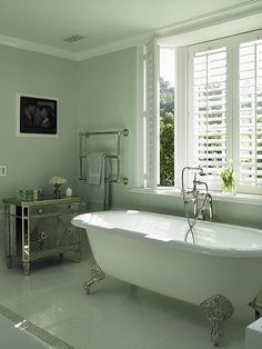 Love this wall color and clawfoot bathtub!