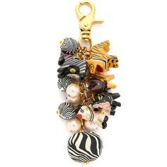 Lenora Dame Safari Bag Charm (245 SAR) ❤ liked on Polyvore featuring jewelry, pendants, zebra multi, safari jewelry, animal jewelry, beaded jewelry, imitation jewelry and lock charm