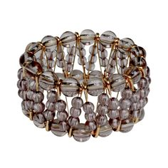 A stretch bracelet featuring rose gold safety pins with small clear beads that intersect with each other bordered by larger beads. Designer: Private Label Condition: New with Tags Measurements: Inner