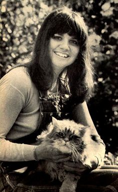 Good ol' Linda Ronstadt knew three things: that cats are awesome, how to rock, and how to wear a good fringe bang