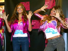 Models Adriana Lima and Gisele Bundchen pose for photographers after leaving cement handprints at the Victoria's Secret store in The Grove shopping mall as part of their 'Angels Across America' promotion  November 12, 2004 in Hollywood California, - #VSFS #VSFS_2004