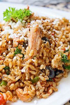 Weight Watchers Spicy Chicken and Rice Skillet Recipe with Olive Oil, Onion, Bell Pepper, Garlic, Cajun Seasoning, Chili Powder, Cumin, Tomatoes, and Black Olives - 6 WW SmartPoints