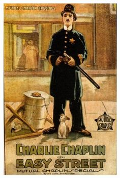 Directed by Charles Chaplin.  With Charles Chaplin, Edna Purviance, Eric Campbell, Albert Austin. A reformed tramp becomes a police constable who must fight a huge thug who dominates an inner city street.