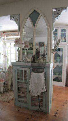 beautify small space with a few well placed fancy corbels, turn a church window with broken glass into a charming mirror, paint a simple cupboard, etc.