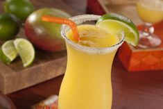 Frozen Mango Daiquiri - Get ready for a cool and relaxing summer when you kick back with one of these frozen fruit drinks. Use fruit vodka. Fruit Juice Brands, Fruit Juice Recipes, Fruit Drinks, Alcoholic Drinks, Drinks Alcohol, Cocktail Drinks, Frozen Drink Recipes, Easy Drink Recipes, Alcohol Recipes