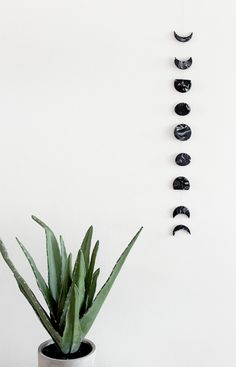 Use clay to make this moon phase wall art.
