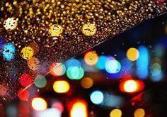 glass rain drops bokeh lights