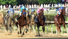 American Pharaoh, left, with jockey Victor Espinoza in the irons wins the 141st Kentucky Derby May 2, 2015 at Churchill Downs in Louisville, Kentucky.      (Skip Dickstein