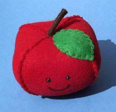 plush hand stitched vegan felt apple with smiley face. $14.00, via Etsy.