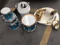 Drums. Horns. Bucket of accessories. In New Orleans.