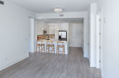 Clean, modern apartment layouts can be accentuated by simplicity. A nice coat of white on the walls and a unique wood-style floor can go a long way.