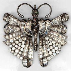 """Art Deco style. Brooch-pendant """"Butterfly."""" White gold, round diamonds and baguettes. Oxidized with Taurus and seems inlaid with colored stones  and diamonds."""