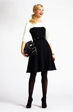 Color-blocked Dress. This outfit will allow you to follow trends in a professional way. The black hose and heels are a more traditional look, but feel free to try opaque black tights, nude hose, or bare legs.------------ For more business, marketing, and presentation tips, visit www.HugSpeak.com
