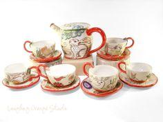 "Ceramic Rabbit Tea Set by Susie Wilburn $300 (Pot 5"", Saucers 3"")"