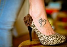 Show your love for soulful music with a music heart tattoo