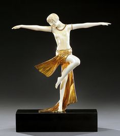 An Art Deco bronze and ivory by Claire JR Colinet, France, circa 1920s.