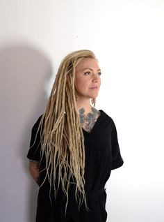 This is Maria, last fall she came to me with the wish of getting dreadlocks done. She had been wearing hair extensions for years but decided to go for her dreams of a big hair of dreadlocks. She looks like a natural dreadhead in my oponinon. What do you think? This photo was taken last week when she came in for some dread lovin.