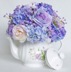 This listing is for a Lovely Teapot Silk Flower Arrangement of Beautiful Lavender Roses, Multi-Color Pastel Ranunculus and Tiny Hydrangea in