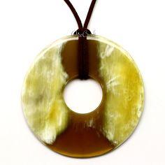 A beautiful pendant handmade from buffalo horn. High polish finish. Lightweight. Actual colors may vary. 3.15 (8cm) diameter.