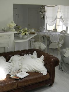 I could do this type shabby-chic with my dark brown leather furniture!