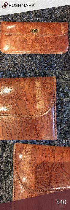 Vintage Genuine Leather Tan Clutch Women's Vintage Genuine Leather Tan Wallet with Elephant Motif. I tried to post pictures of every imperfection. It look like it may have had straps at one point and some of the finish was rubbed off when it was removed. Not urban, just tagged for exposure. Urban Outfitters Bags Clutches & Wristlets
