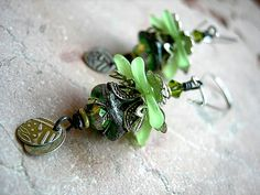 Elven Flower Earrings . Green & Silver Earrings . Glass and Resin Flowers . Silvery Filigree. $27.00