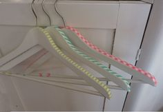Very cool - paint hangers picked up from junking and add washi tape. Great for guest room!
