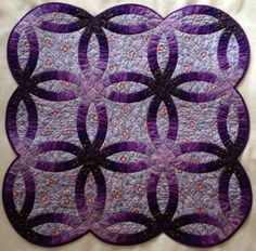 My purple Wedding RIng quilt, handsewn and hand quilted. It's 86 by 86 centimeters.