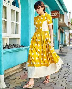 Yellow Tie Dyed maxi dress with a high neckline, perfect for casual…