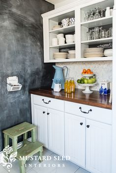 I think I'm going to take the doors off my cabinets by the sink and display all my pottery I use there. A small transition to going to full open shelving.  Kitchen Reveal & Sources - Miss Mustard Seed