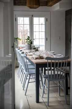 Wooden table with light coloured chairs