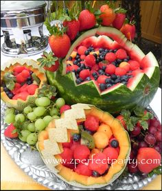 Summer Fruit display, watermelon, cantelope for graduation party; love edible centerpieces