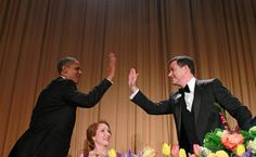 President Barack Obama high-fives late-night comic Jimmy Kimmel as Caren Bohan, a Reuters journalist and president of the White House Correspondents' Association watches during the White House Correspondents' Association Dinner, Saturday, April 28, 2012 in Washington. (AP Photo/Haraz N. Ghanbari)