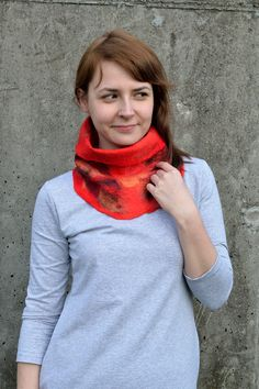 Unisex red cowl scarf made of merino and silk fibers. With its bright colors and tube design it will make your springs and autumns warm and exciting.
